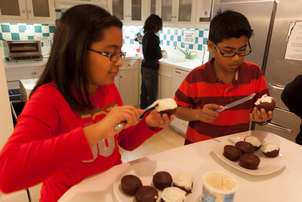 Fifth-graders Joanne Mata and Steven Inderdeo were among 11 students who volunteered their time last Sunday.