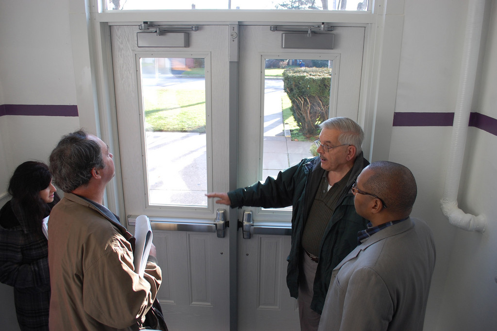 District 30 Facilities Director Greg Abbate, second from right, showed board members Elise Antonelli and Jim Lavery, and Superintendent Dr. Nicholas Stirling, new doors that were recently installed at the Clear Stream Avenue School.