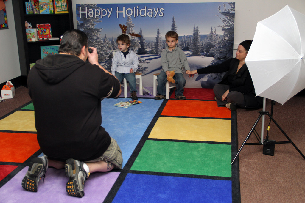 Photographer Rich Matarazzo snapped holiday photos of Nicholas and Peter Roidis at the Salisbury Center while their mother, Elyse, offered encouragement.