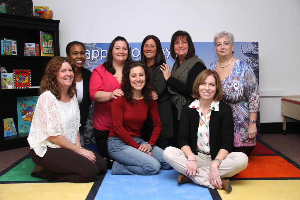 Kids First staff members, from left, Kim Hunt, Lauren Chopyk, Ina Belferber, Grace Winkler and Anita Friedman, and bottom row, left to right, Tara Miguel, Angela Russo and Dawn Plumitallo smiled for their own holiday photo.