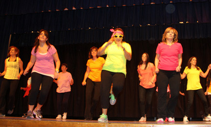 Jericho High School teachers and staff surprised the audience before intermission with a fun lash-mob dance.
