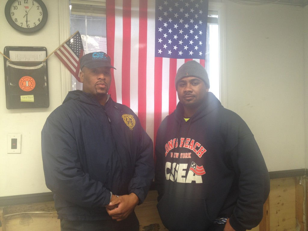 Sanitation employees Terrence Harris, left, and Devin Parker are raising money for the Sandy Hook School Support Fund.