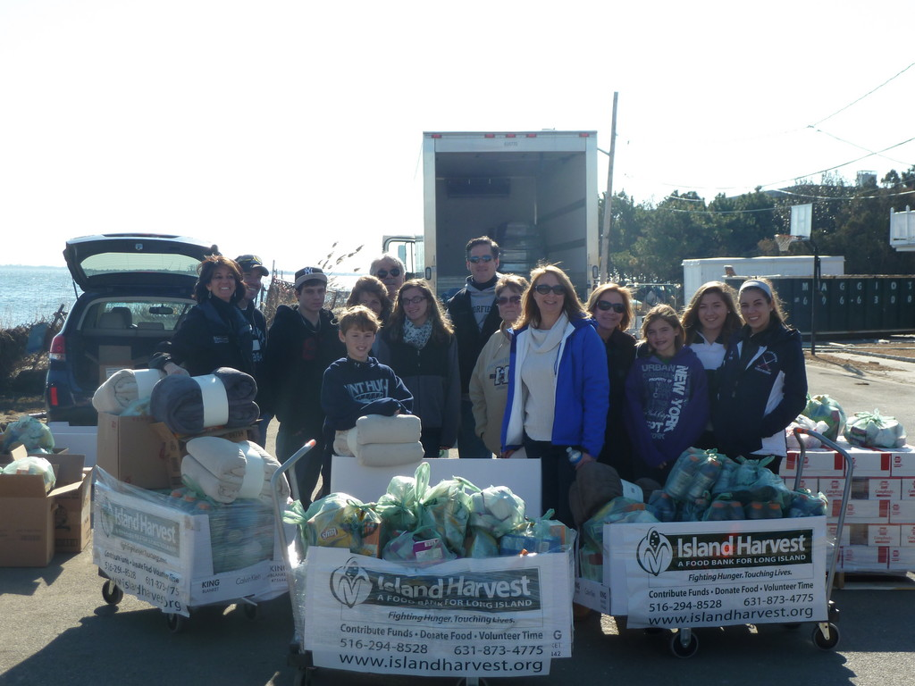 Island Harvest President and CEO Randi Shubin Dresner, far left, and staff and volunteers have been aiding hurricane victims across Long Island.