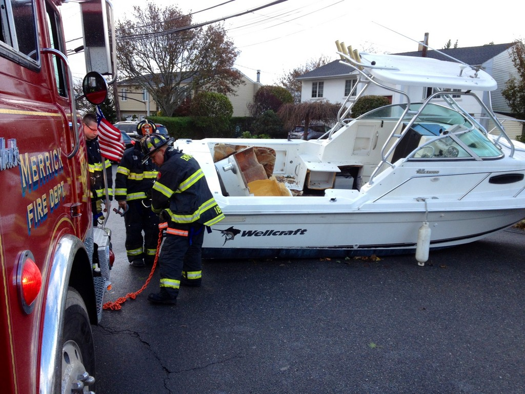 Among the Merrick Fire Department's many duties after the storm was removing boats that the storm had lifted from their docks onto Hewlett Avenue in south Merrick.