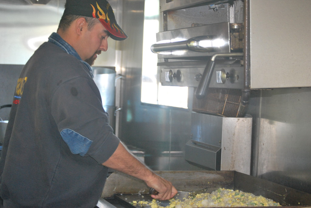 Meadowmere Park Fire Chief Kevin Carrero cooked eggs on the grill for community members who needed a hot breakfast after the devastation of Hurricane Sandy. Under his leadership residents, whose homes were damaged or destroyed found a safe haven at the firehouse.