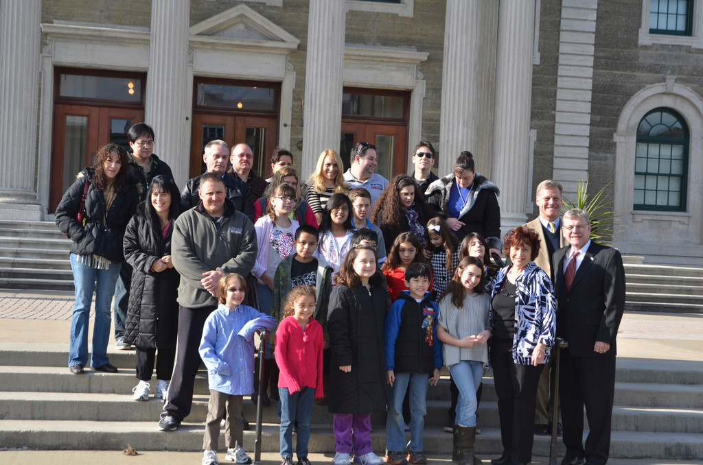 The talented artists stood on the steps at the Nassau County Legislature.