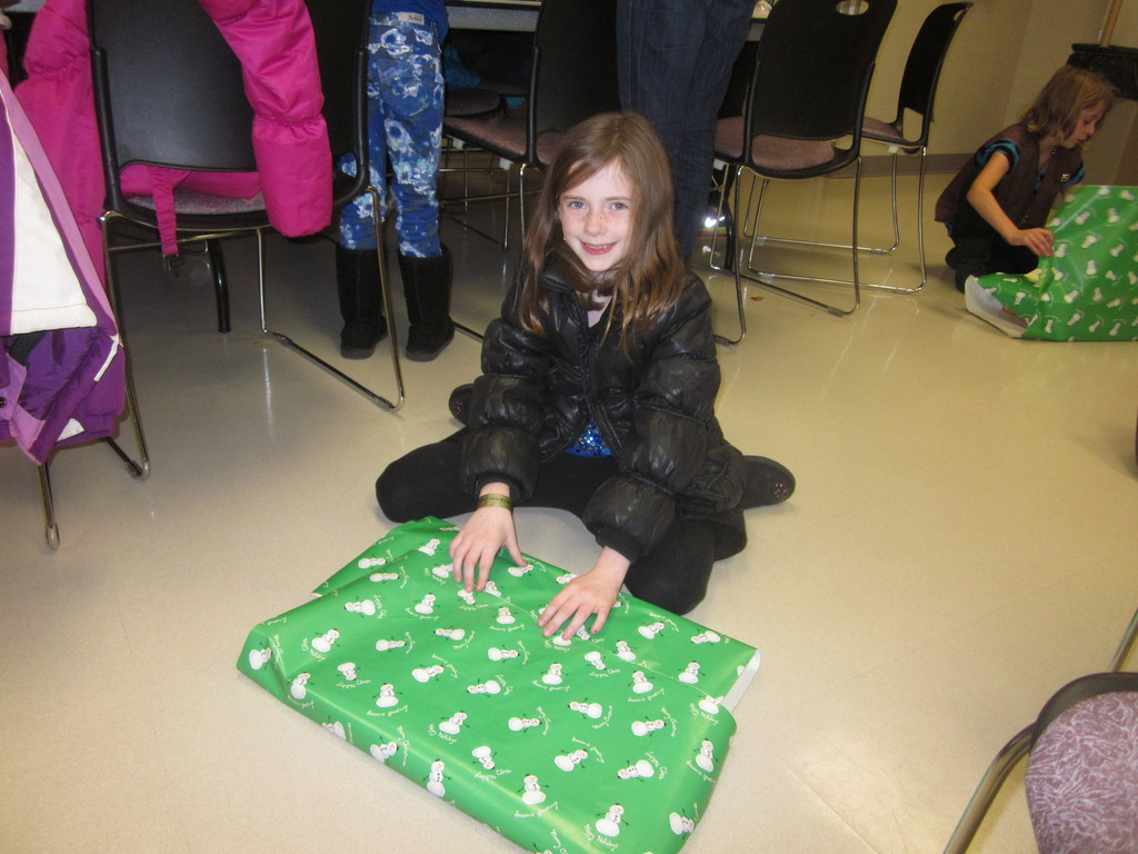 Lauren Nunez, from Troop 1266, helped wrap the presents.
