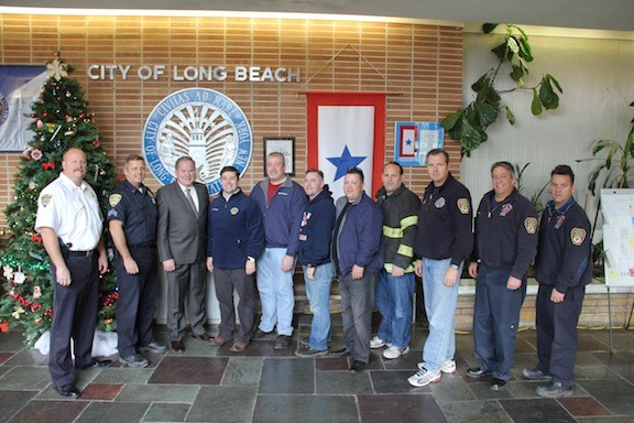 Sgt. Eric Cregeen, far left, police officer Ed Ryan, Police Commissioner Michael Tangney, City Manager Jack Schnirman, Department of Public Works Commissioner Jim LaCarrubba, Thomas Canner, Chris Windle, Building and Fire Commissioner Scott Kemins, Fire Chief Richard Corbett, Lt. Tom O�Dowd and Long Beach Professional Firefighters Local 287 President Bill Piazza.