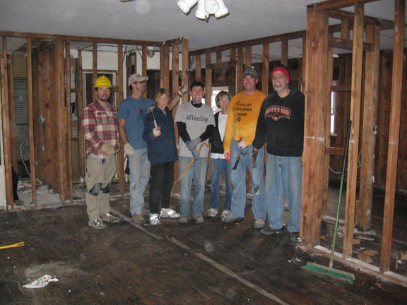 Michael Glass, left, Tim O�Leary, Eileen Hession, Bryan Murphy, Kathy Levine, Andy Kiernan and Jim Giambalvo worked to gut Levine�s home on State Street.