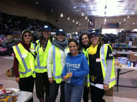 Stacey Ebert, fourth from left, helped coordinate the city�s volunteer and distribution operation at the Ice Arena.