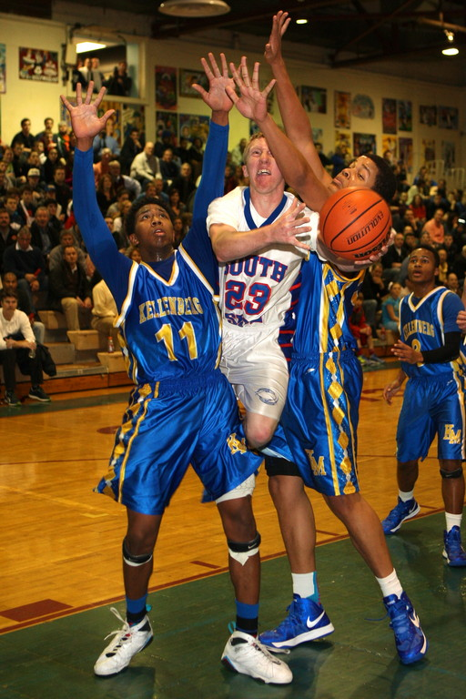 South Side's Brendan McDerby, center, squeezed between Kellenberg's Jeremy Arthur, left, and Brian Gellineau.