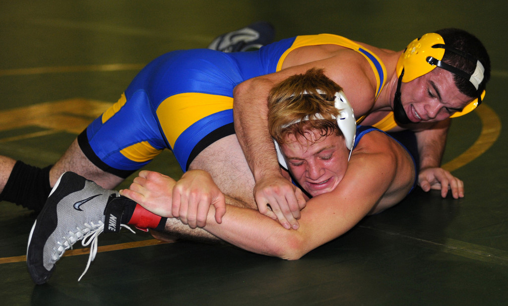 East Meadow's Michael Tropiano, top, reached the finals of the Battle at the Beach tournament to open the wrestling season.