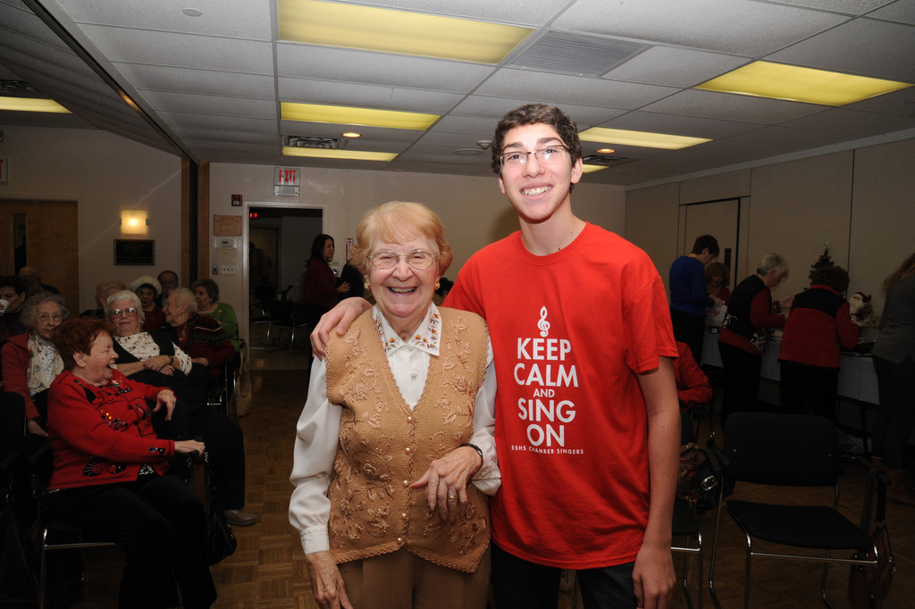 Neighbors Margaret Paradiso and Nick Dell'amore, 15, at the intergeneration party held at the Sandel Senior Center in Rockville Centre.