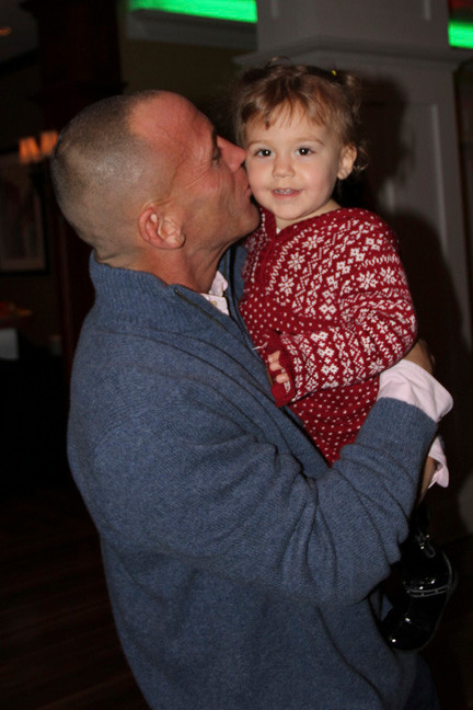 Russ Cohen and his daughter, Sami, celebrate the season at the Best Western Hotel with other displaced Hurricane Sandy victims