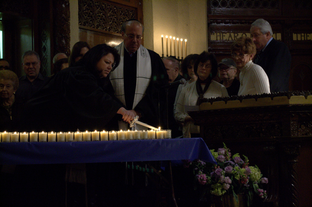 Cantor Galina Makaveyev lit one of the 26 candles that Temple Israel congregants and clergy burned to remember the children and adults killed in Newtown, Conn.