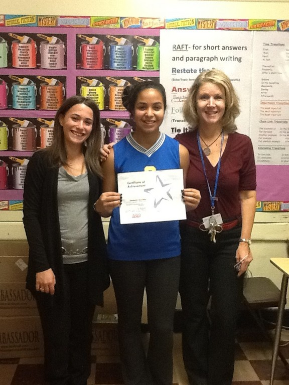 Lawrence Middle School student Danielle Portillo was recognized for her essay on bullying. From left were, English teacher Fallon Bienstock, Portillo and English teacher Helene Cukierwar.