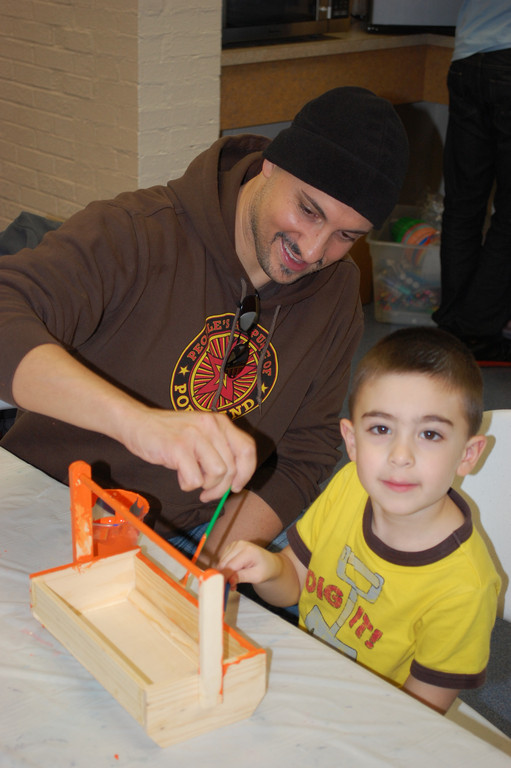 Anthony Sarcone, 4, and his father, Michael, teamed up to create and paint a toolbox.
