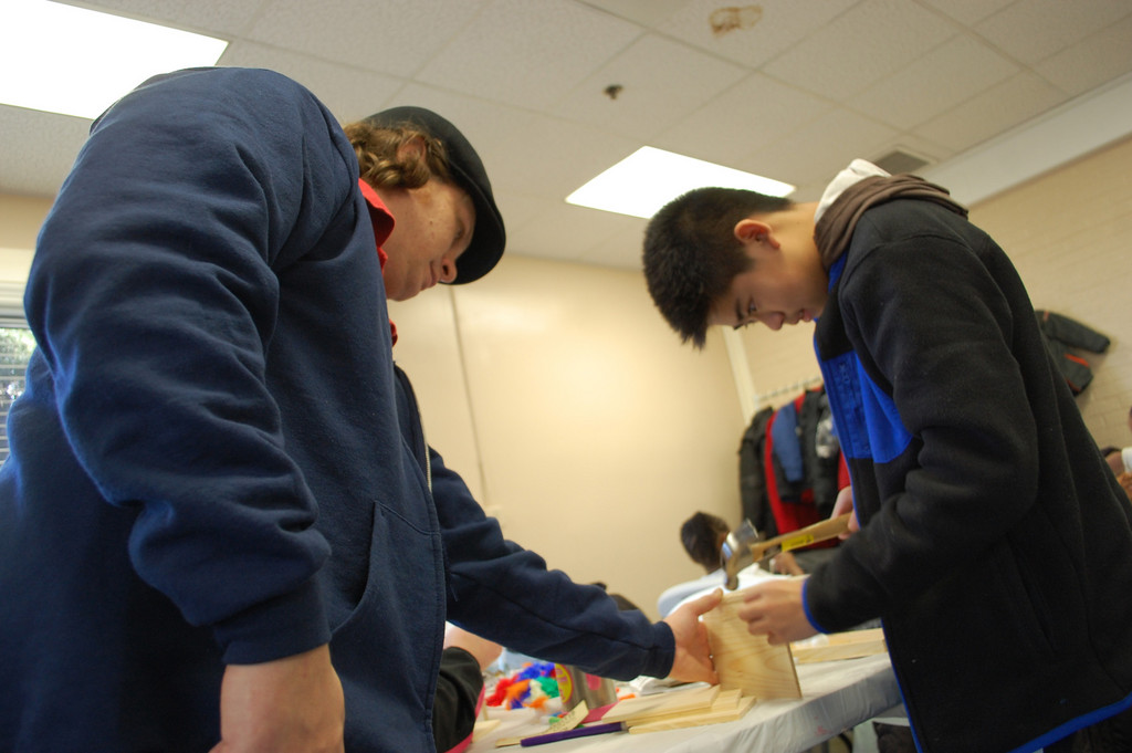 Poray Chan, 11, worked on a birdhouse with the held of Recreation Supervisor Brian Kennedy at the Hendrickson Park Community Center last Friday afternoon at the village's Winterfest crafts day.
