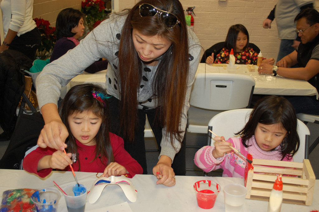 Meoldy Chen and Katelyn Yeh, both 5, worked on various crafts projects last Friday with the held of Katelyn's mother, Mimi.