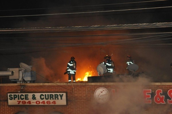 EMFD volunteers fought the flames from the rooftop of the Spice and Curry Halal Meat store.