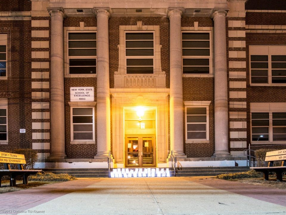 Event organizer Jessie Farrell placed 26 luminary bags on the steps of East School to also honor the lives lost in Newtown, CT.