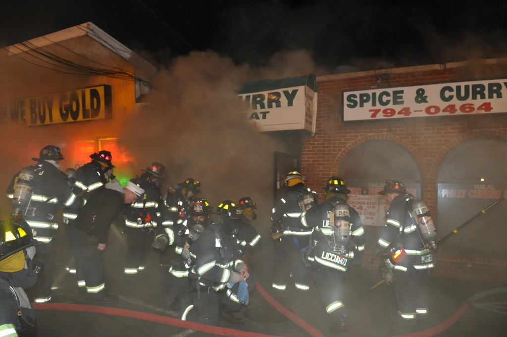 Firefighters responded to a commercial fire at Spice and Curry on Hempstead Turnpike on New Year's Day. The fire spread to two adjoining businesses before being controlled by firefighters.
