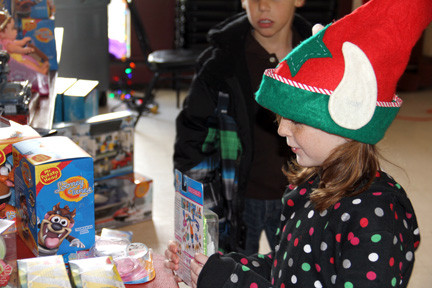 Colleen Reichel checked out the many toys at the Island Park Fire Department holiday celebration.