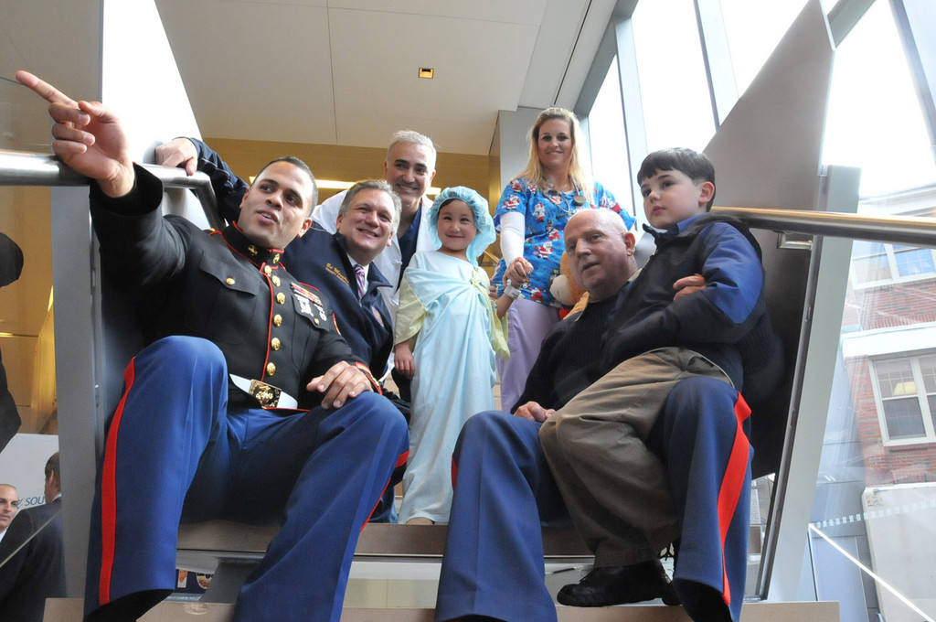 Many people came out to wish Marzieh well before her surgery. Pictured, from left, are Sgt. Gomez, who brought toys from the Toys for Tots program; Nassau County Executive Ed Mangano; Dr. Kaveh Alizadeh; Marzieh; a SNCH nurse; Major Chuck Killbride and his grandson Patrick.