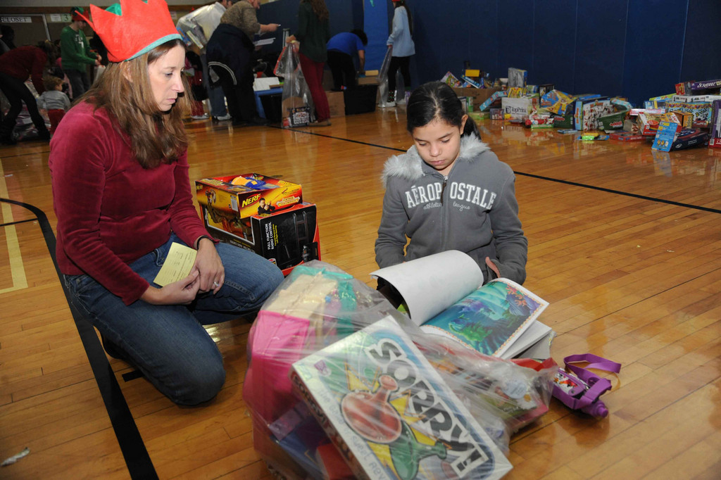 ELF Susan Cohen helped Kaeleen Collado pick out toys.