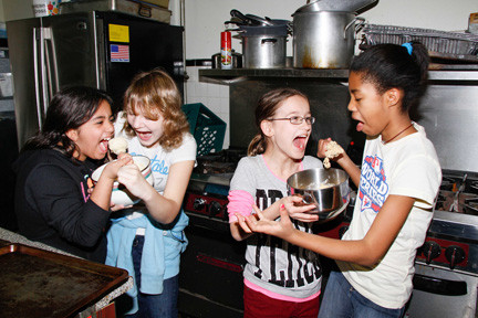 Caterina Scolpino, far left, 11, Svetlana Lagos, 13, Mary Penson, 11 and Amanda Lashley, 11, from Girl Scout Cadet Troop 198, made cookies to send to troops overseas.