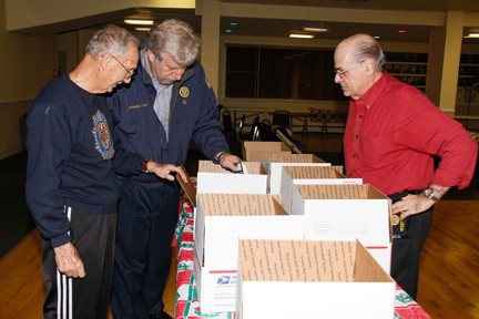 Michael Guerriero,  American Legion Post 1087's 2nd vice commander, far left, Ed Giacin, commander and Charlie Forzano prepared care packages.
