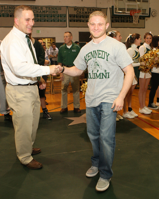Alumni wrestlers like Zach Cogan, above, were honored at the match.