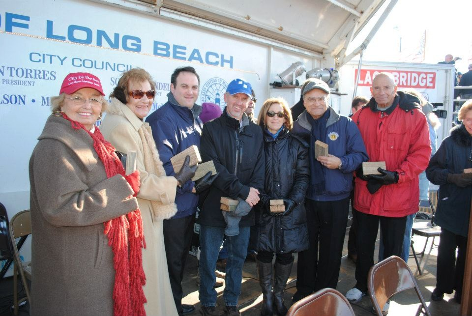 Long Beach Historical Society members Roberta Fiore, left, and Carole Geraci, council members Scott Mandel, John McLaughlin, Fran Adelson and Len Torres, with Assemblyman Harvey Weisenberg.