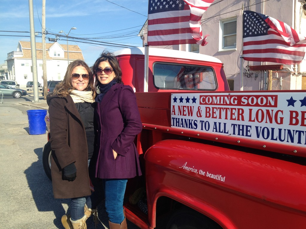Ivy Garbowitz, left, and Christiana Baggie were among the 3,000 people who turned out for the boardwalk ceremony.