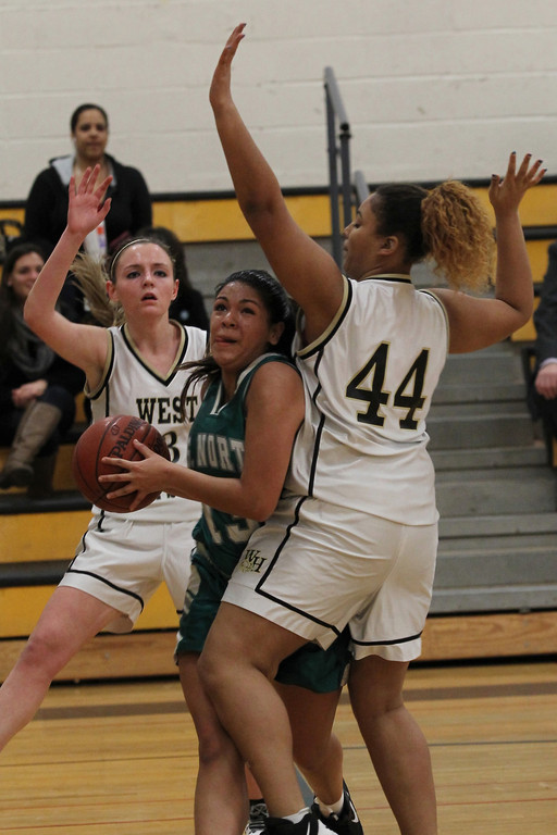 West Hempstead's Jackie Christenson, left, and Cyndee Davis, right, defend against Valley Stream North's Alexis Contrereas.