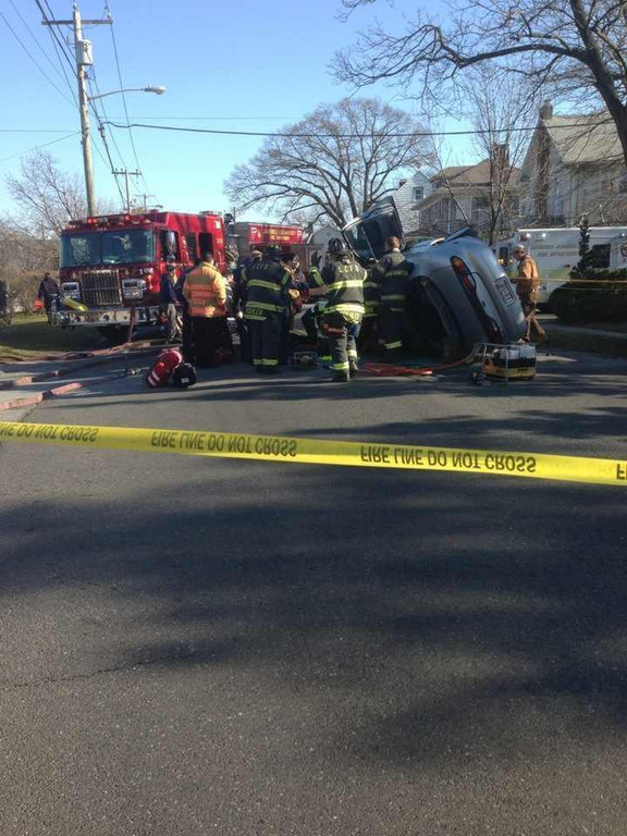 Lawrence-cedarhurst firefighters rescued a woman from her overturned car in Cedarhurst.