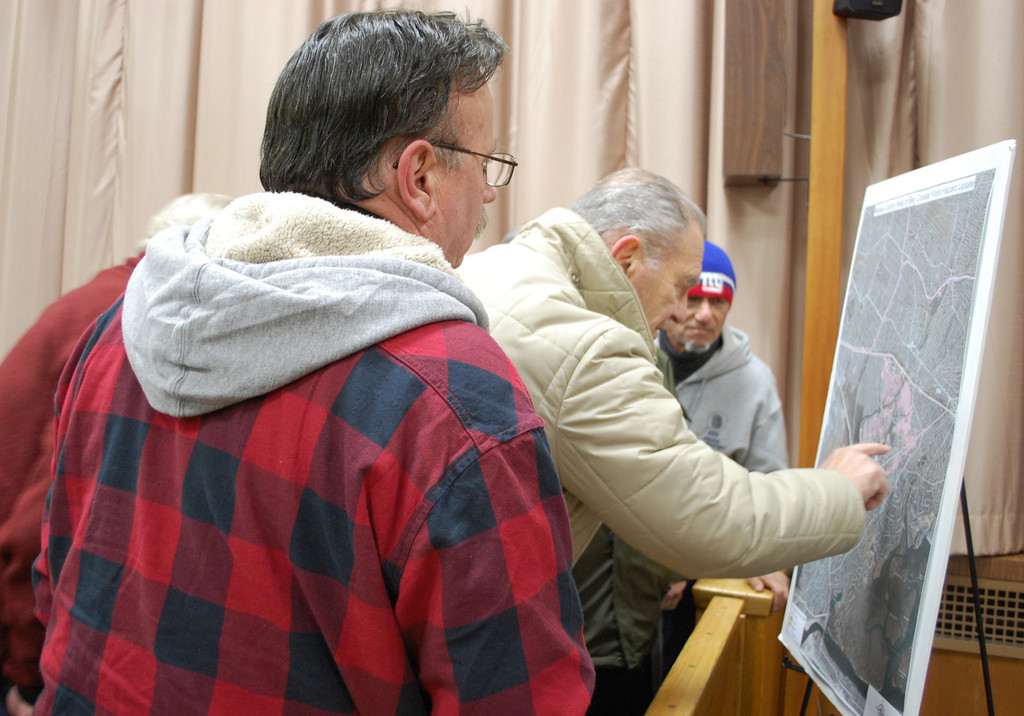 Valley Stream residents checked the new maps released by the Federal Emergency Management Agency at Village Hall on Jan. 2 to see if their homes would be coming out of the flood zone.
