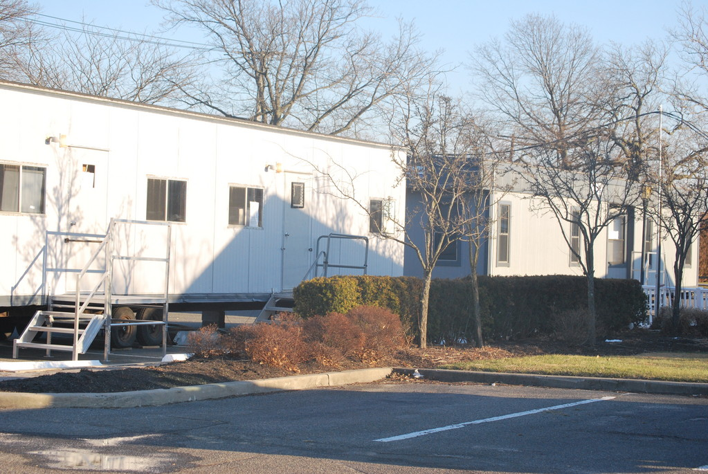 Two trailers on the grounds of the Lawrence Yacht & Country Club are now housing club offices, left, and club members.