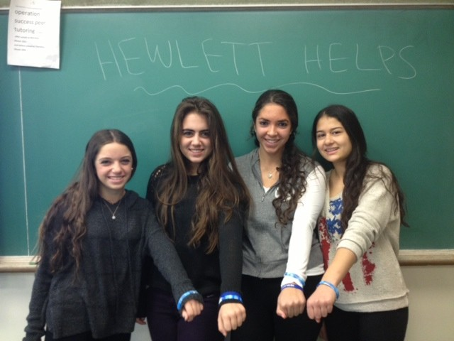 Hewlett High School's sophomore student council sold bracelets imprinted with the words Hewlett Helps and raised more than $1,000 for Hurricane Sandy relief. From left were student council members Amanda Goffner, Renee Kaplowitz, Valerie Elefante and Margaret Feldman.