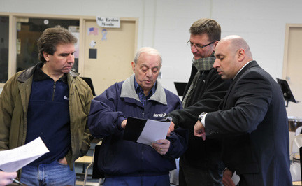 Board members and administrators went over plans to improve Memorial Junior High School's main parking lot. From left were Trustee Joe DiSibio; board President Anthony Iadevaio; Dr. Wayne Loper, assistant superintendent for finance and operations; and Memorial Principal Anthony Mignella.