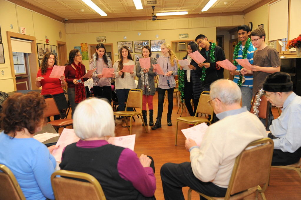 Hewlett teachers and Students visited the Center for Adult Life Enrichment and sang seasonal songs, distributed holiday cards and played bingo with the center members. The get together forged new friendships.