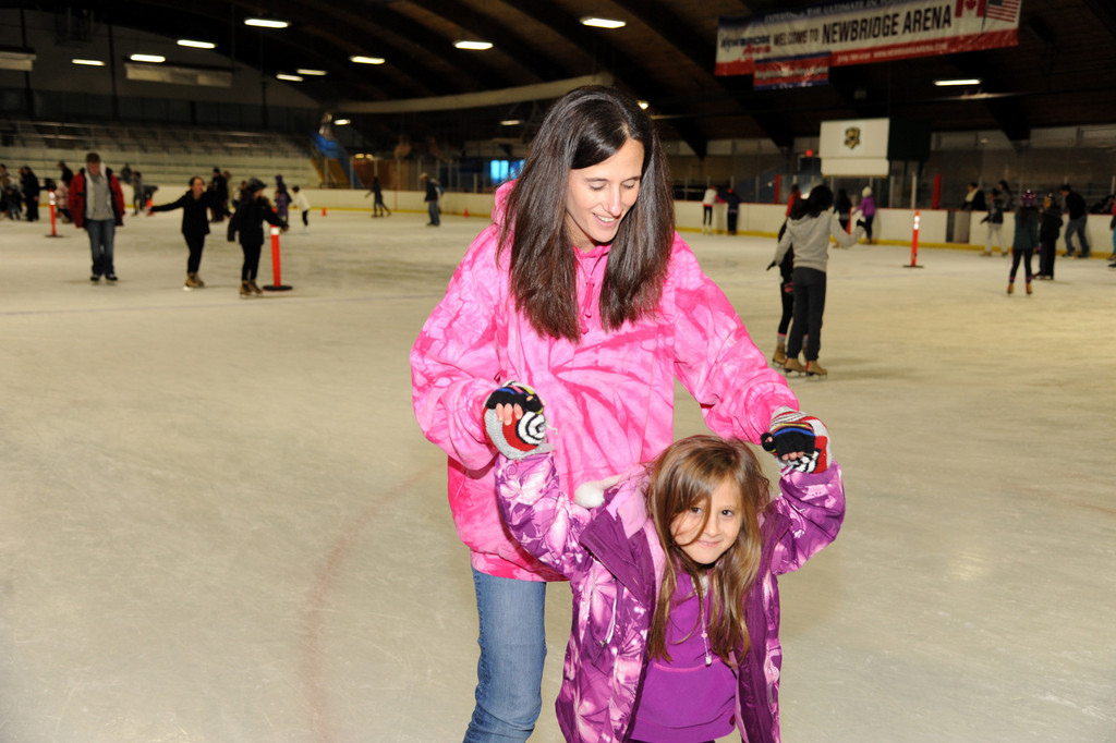 Lisa Martin helped Jessica, 5, find her footing on the Newbridge ice.