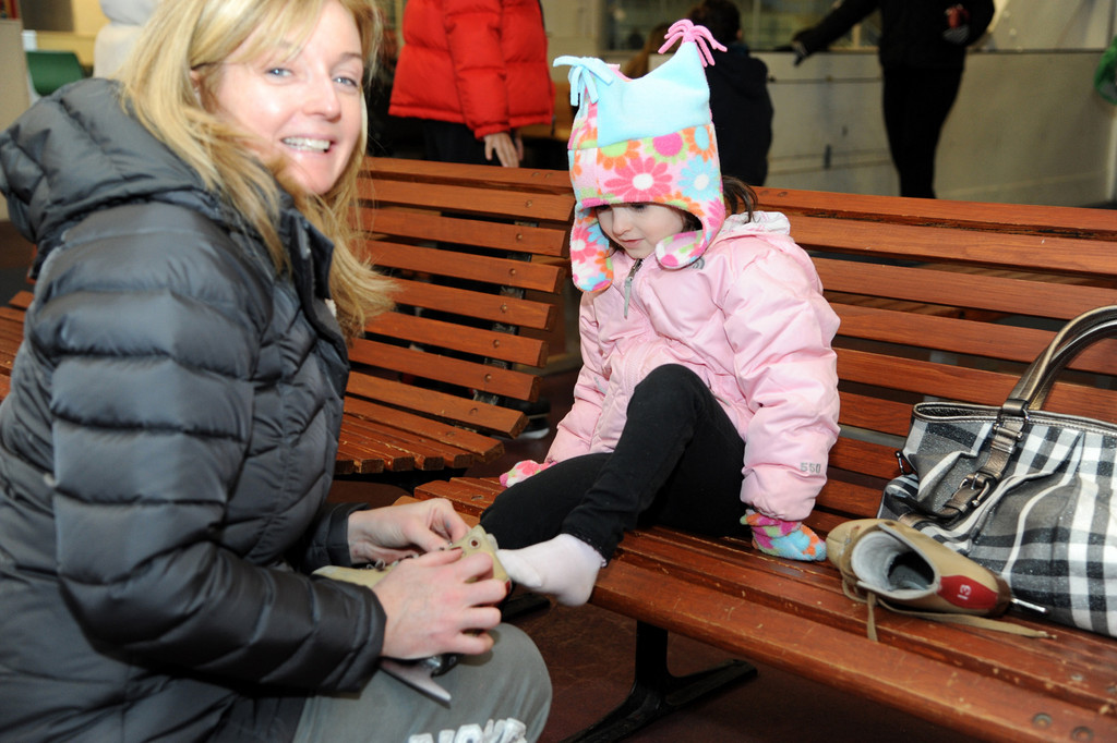 Jennifer Minogue, left, got her daughter ready to hit the ice at the Newbridge Arena.