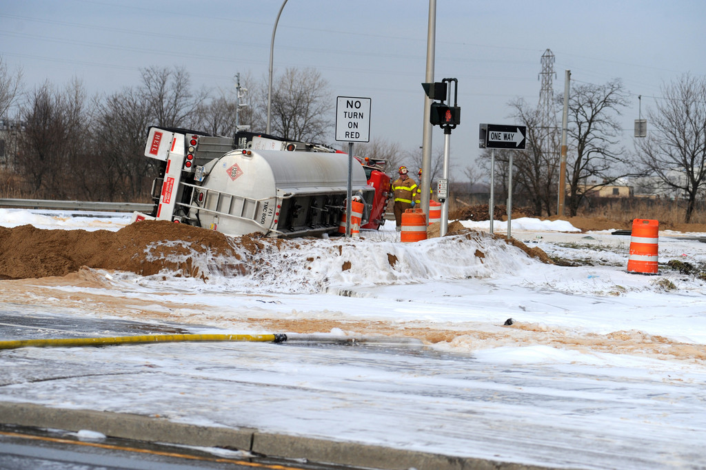 A CBH Transport gasoline tanker overturned coming out of the Inwood depot and spilled a full load onto the Nassau Expressway.