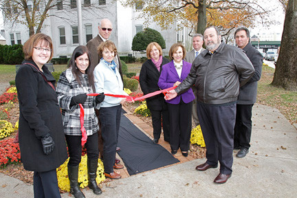 RVC Community fund members and village officials dedicate a new brick pathway in front of village hall. From left to right,  Jeanne Farnan Mulry, Sue Bevilacqua, Jane Rinn, Trustee Ed Oppenheimer, Deputy Mayor Nancy Howard, Joan Hope MacNaughton, Mayor Francis X. Murray, Village Administrator Keith Spadaro and Marty Bevilacqua cut the ribbon.