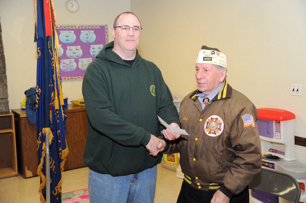 Andrew McClure accepted the donation from VFW Commander Sal Pellegrino.