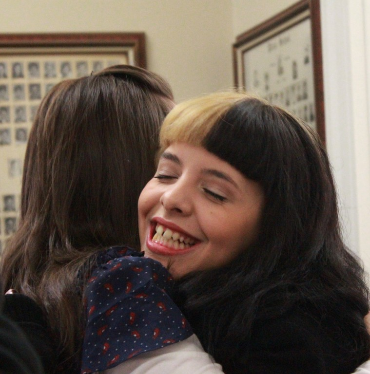 Melanie enjoyed a hug from a former teacher.