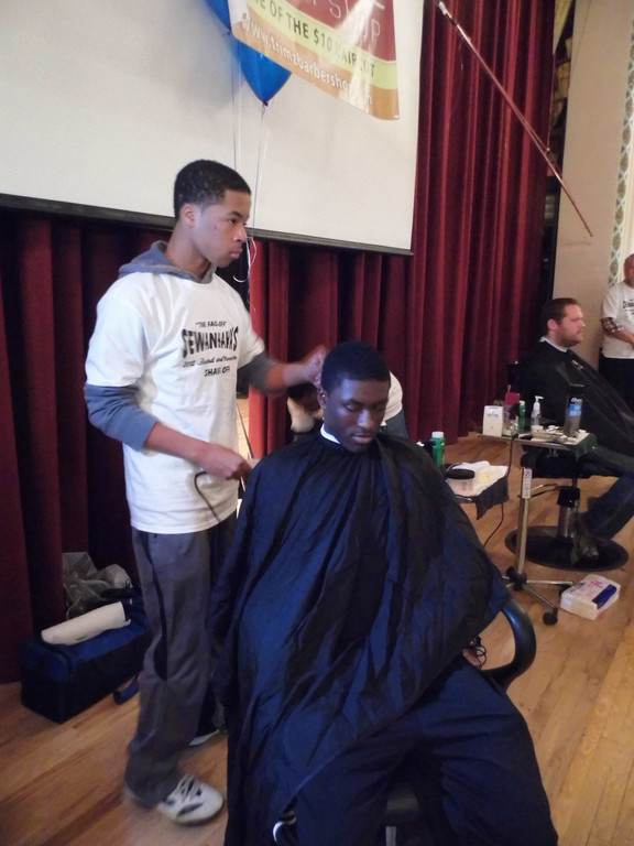 Sewanhaka students get their beards trimmed and hair cut for the charity event.