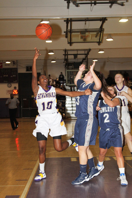Sewanhaka's Shantell McCall, left, scoops in two of her 12 points during a 54-49 victory over Hewlett on Jan. 8.