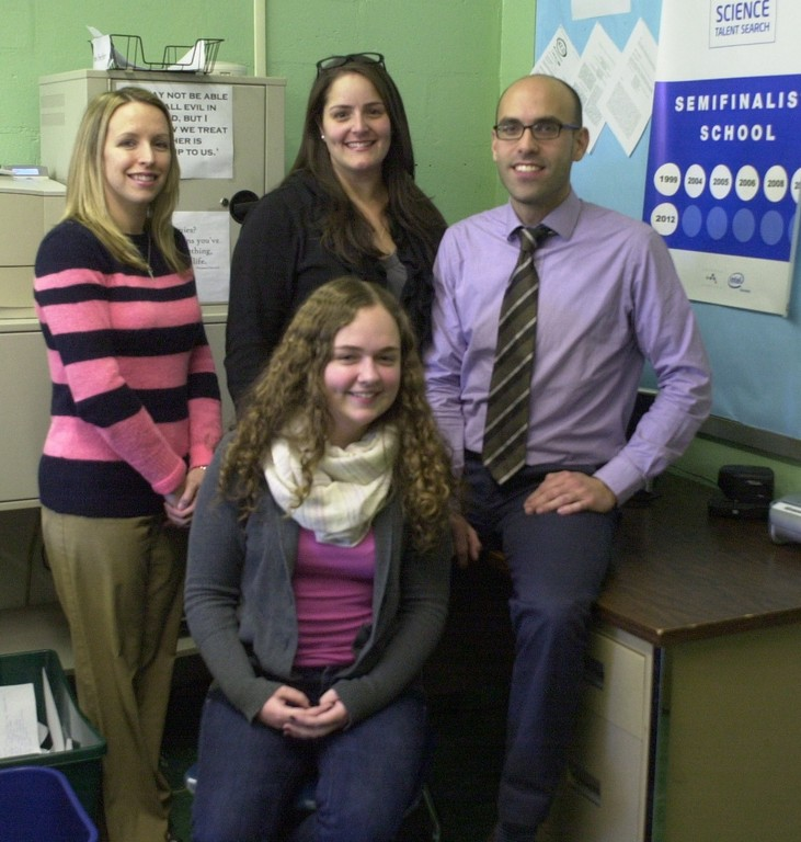 For her Intel project, Calhoun High School science researcher Emma McNamara studied the relationship between the size of female macaques' canine teeth and their dominance in the social hierarchy of their troops. McNamara was joined by her Calhoun science advisers, from left, Jennifer Pefanis, Kimberlie Lascarides and Nick Pappas.